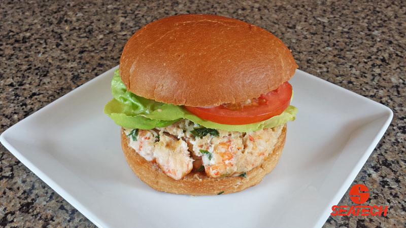 A photograph of a langostino lobster burger.
