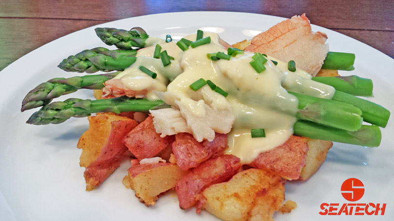 A photograph of red potato crab oscar featuring Seatech Chilean rock crab meat, fried red potatoes, asparagus and hollindaise sauce